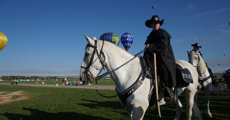 a law enforcement officer is on a horse during the Alburquerque, New Mexico Balloon Festival