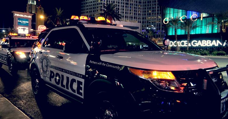A Las Vegas Metro police car patrols the Las Vegas strip