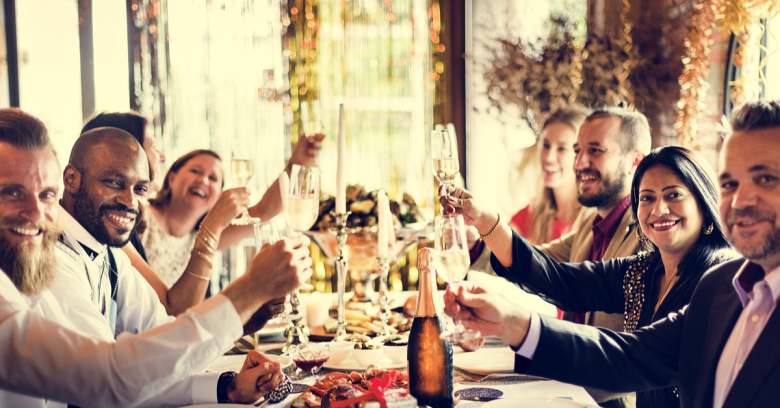 A groups of friends and family makes a toast during the holidays