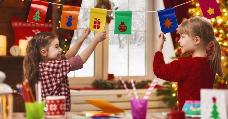 Children enjoy their work on holiday crafts