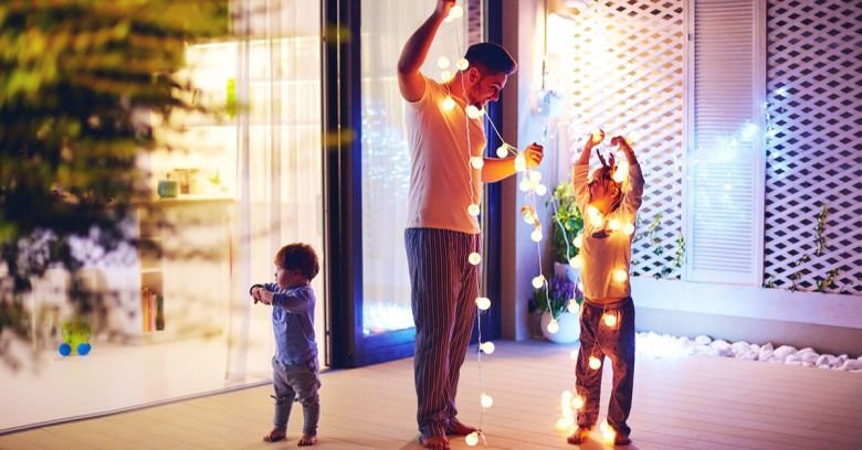 A father and his small children decorate for the holidays