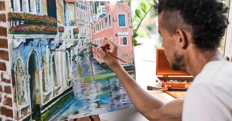 An artist creates a painting