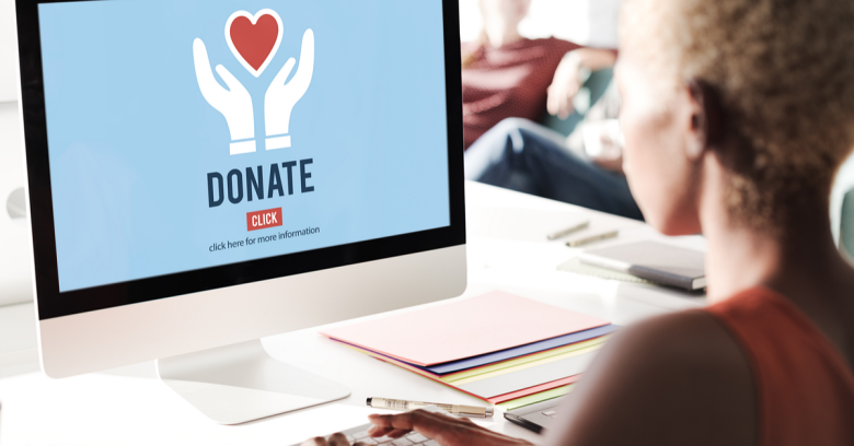 A woman makes a donation using her computer