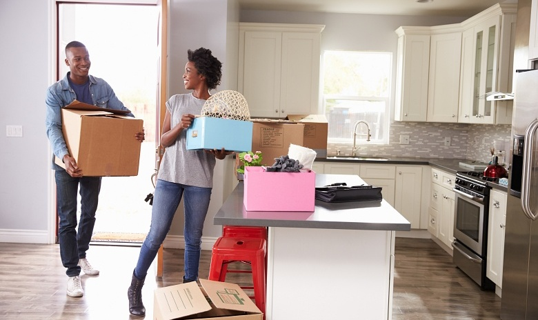 A couple moves their belongings into their new home.