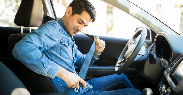 A man buckles his seatbelt