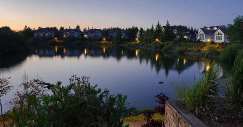Houses dot the shoreline of Staats Lake in Keizer, Oregon.