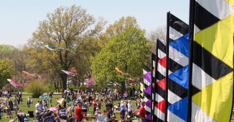 People gather to fly kites and flags at a kite festival in Lee's Summit, Missouri.