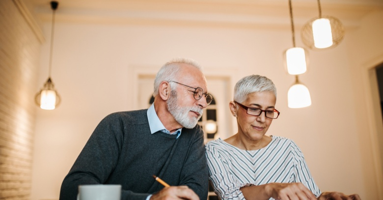 A middle-aged couple discusses how much car insurance they can afford.