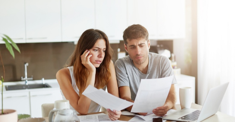 A couple organizes paperwork in order to apply for a home loan
