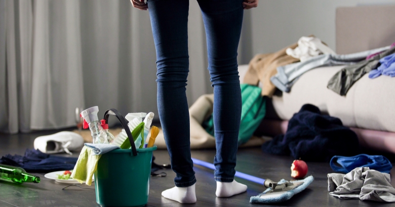 A housekeeper surveys a cluttered room and wonders how she will clean it