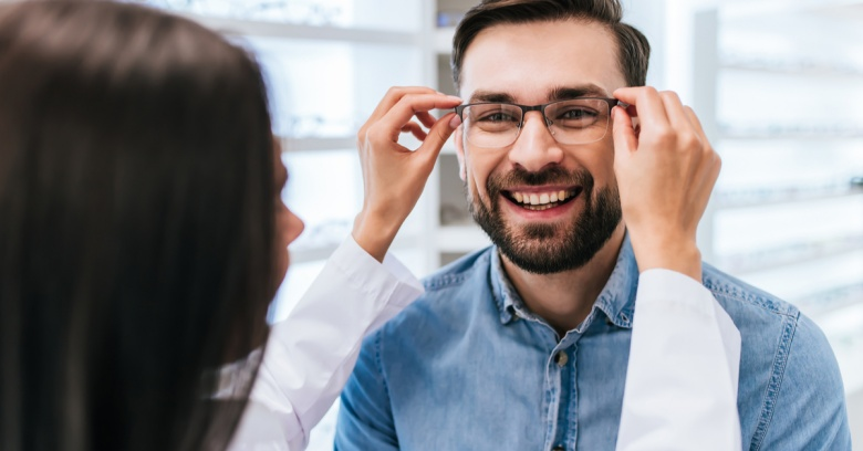 A man uses his flexible spending account to get an eye exam and pay for his glasses
