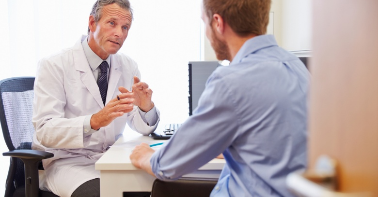 A man discusses his health concerns with his doctor during his annual physical