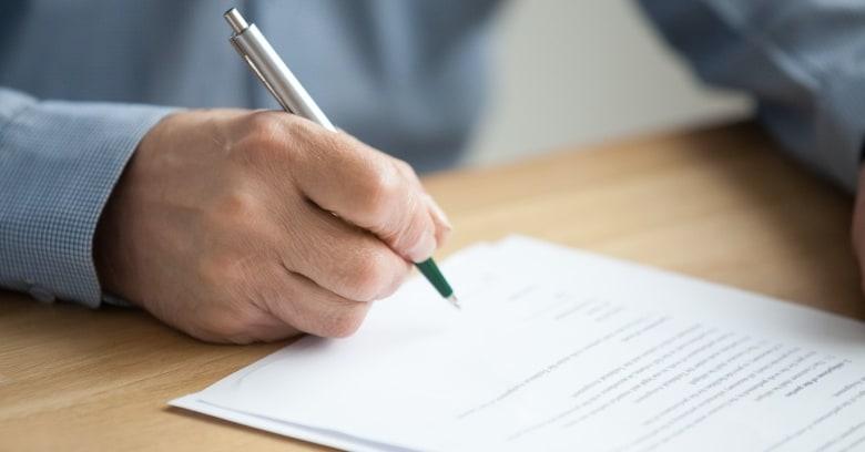A man signs a legal document