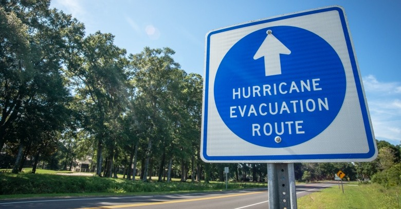 A sign indicates an emergency evacuation route