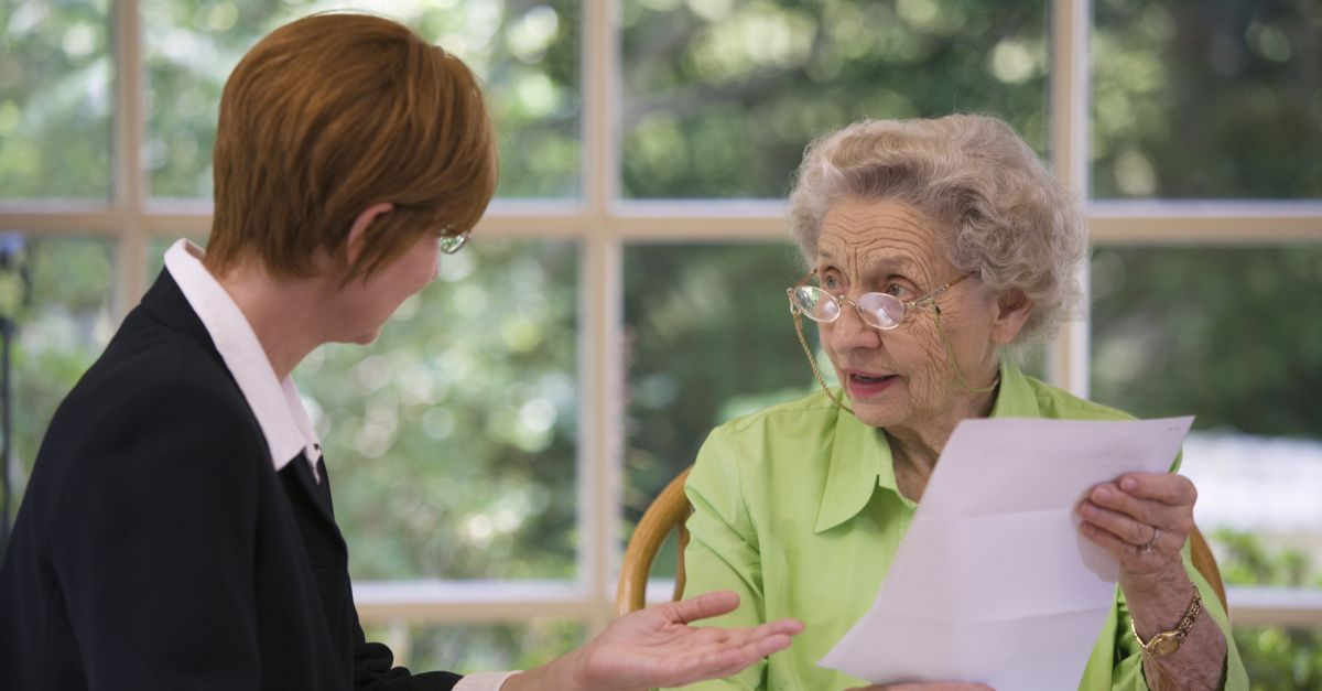 elderly-woman-with-legal-documents_uaa14x.jpg