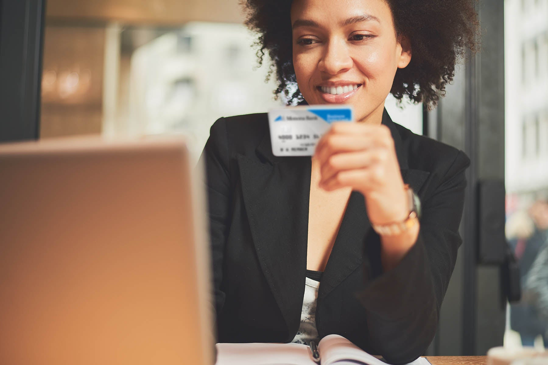 Woman using Business Debit Card