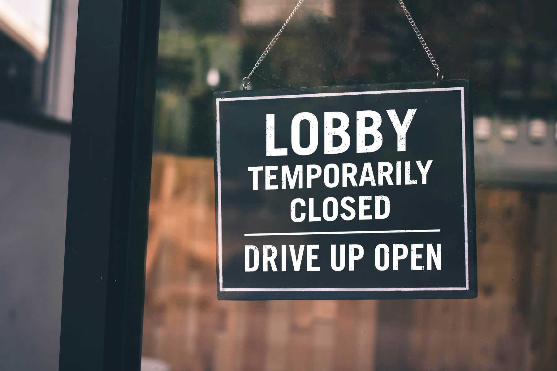 Front store Lobby temporarily closed sign while drive up open