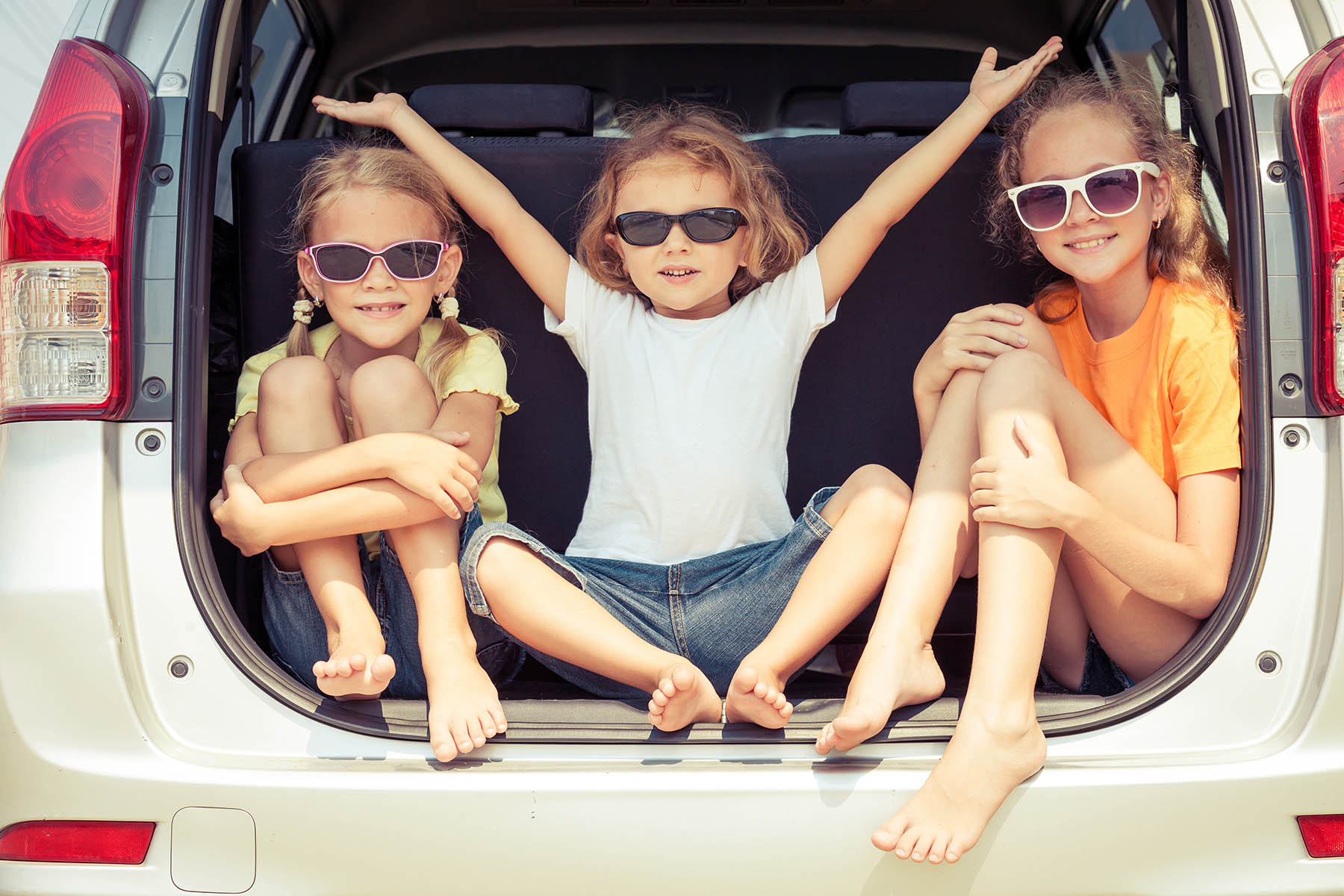 Kids in a car summertime