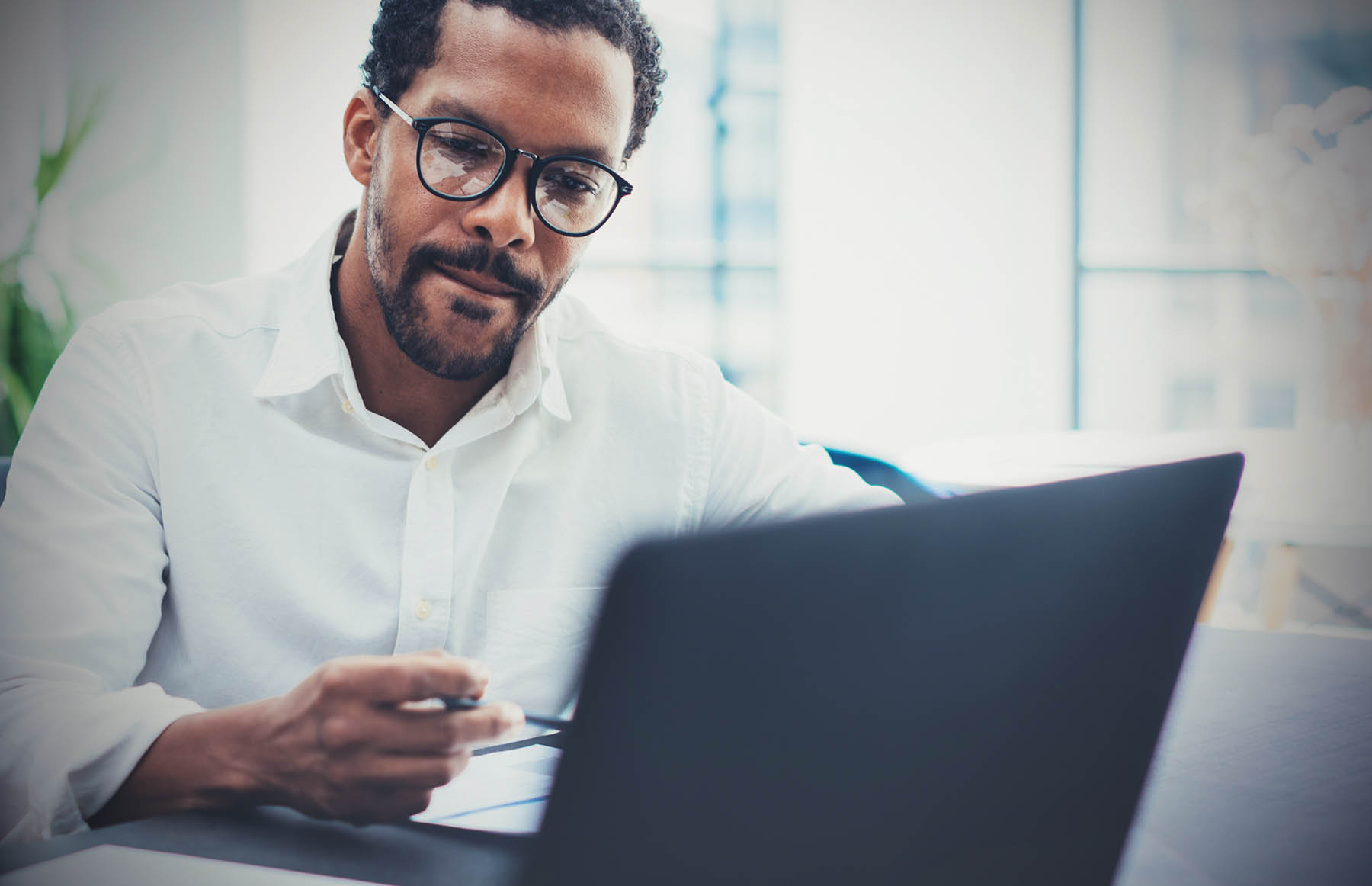 Man managing business on computer
