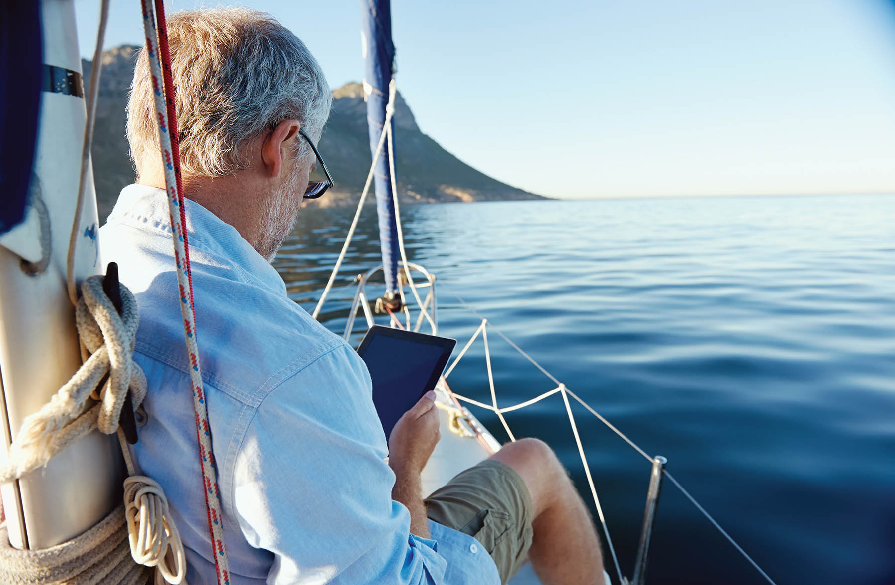Man sailing on iPad shopping