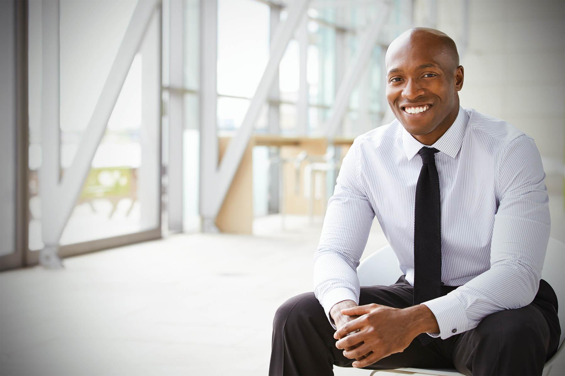 Businessman in office in suit