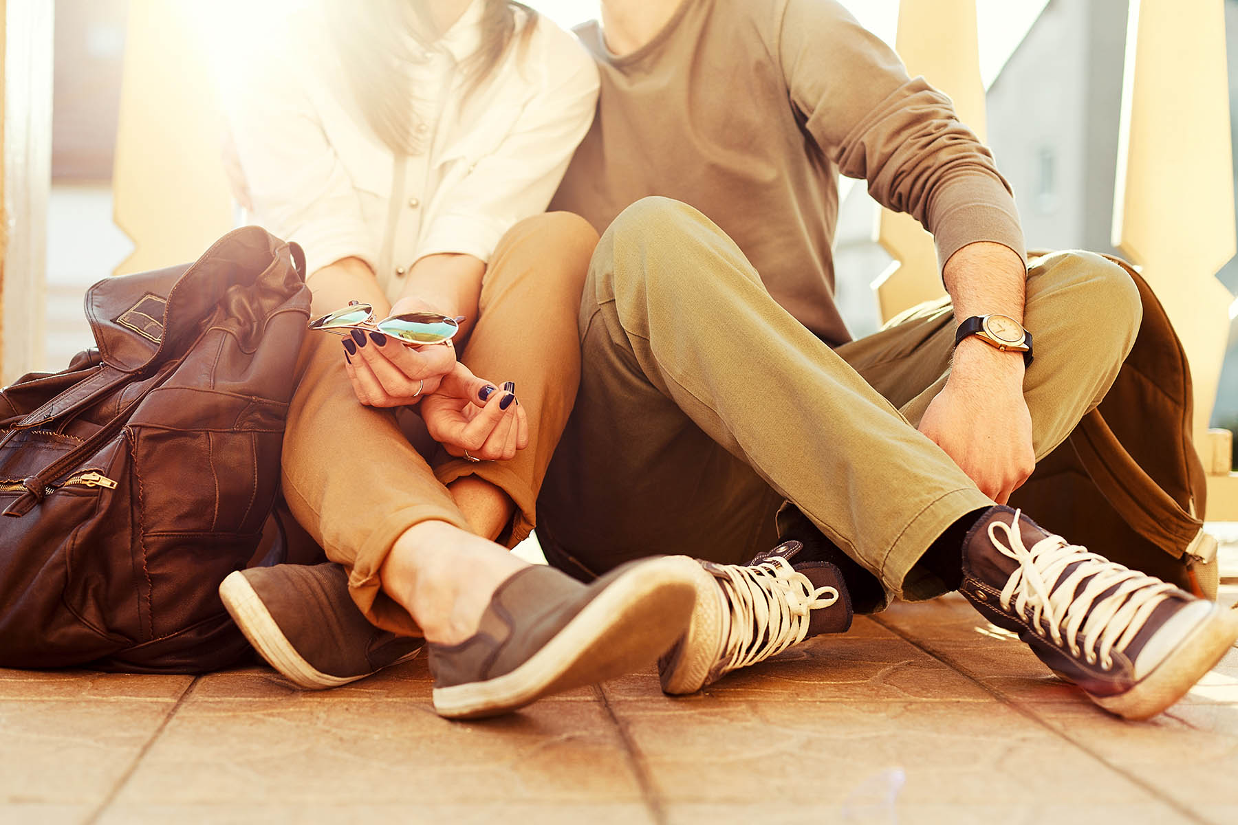 couple sitting on floor in the sunlight