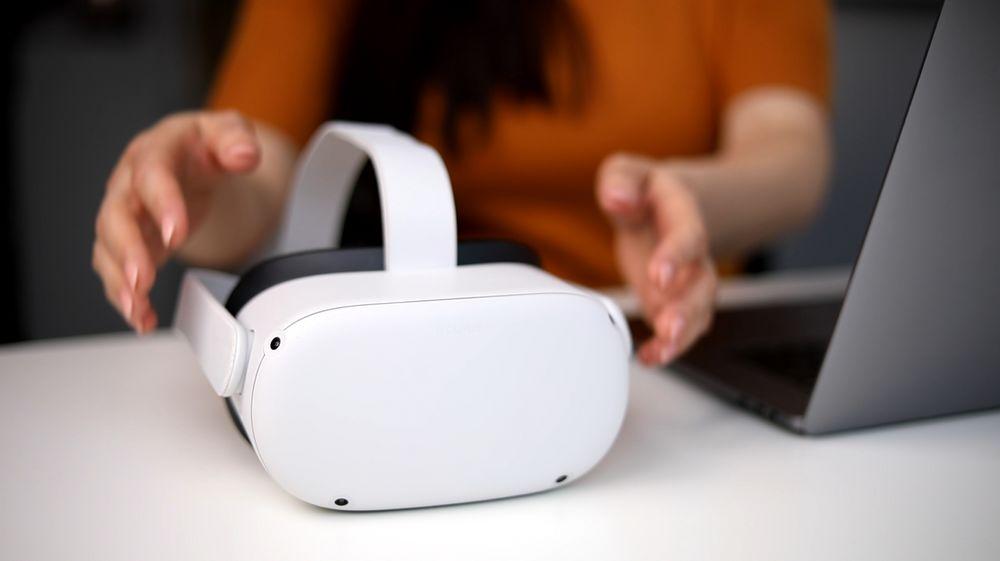 Girl pickup an Oculus Quest 2