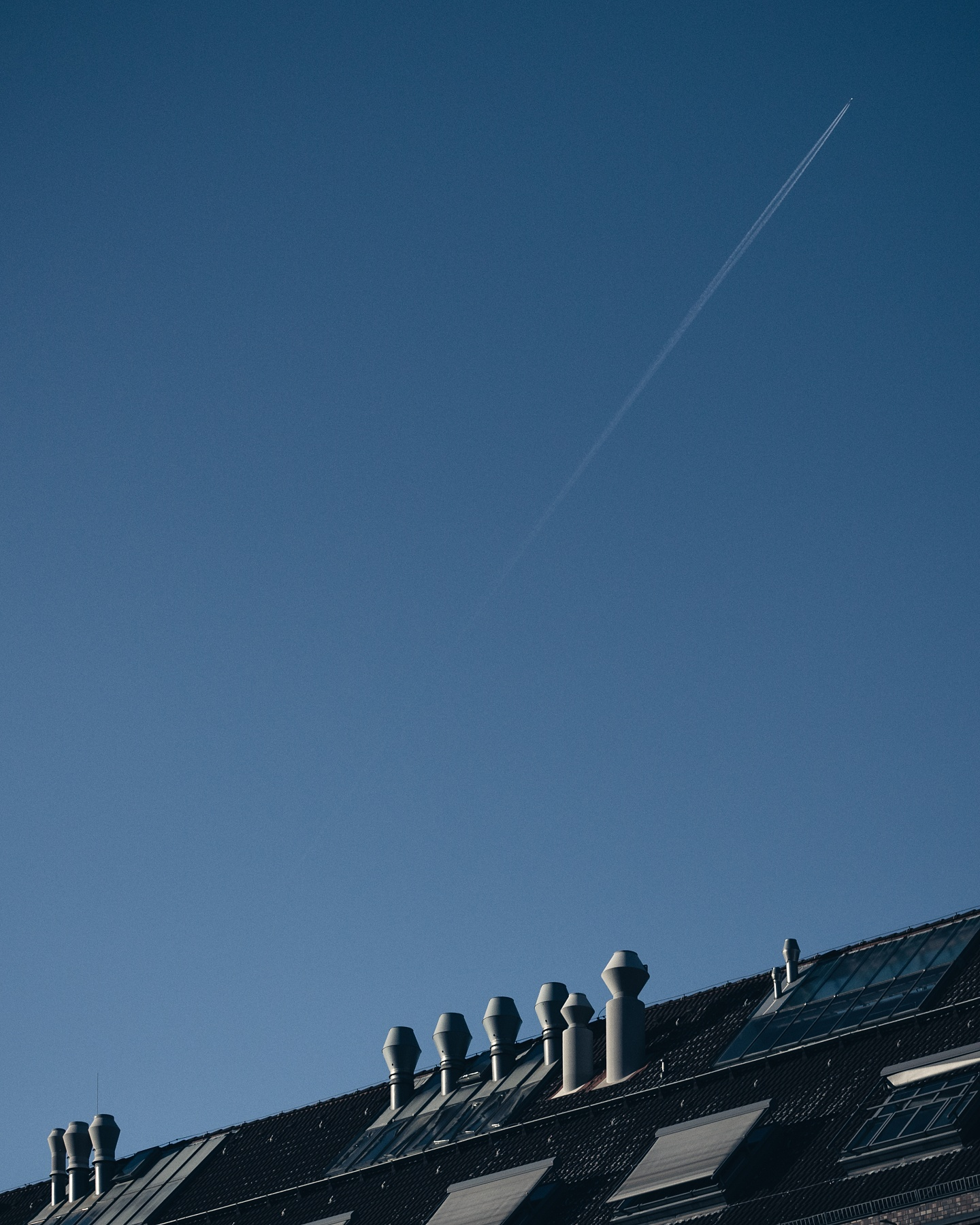 Airplane flying over a roof