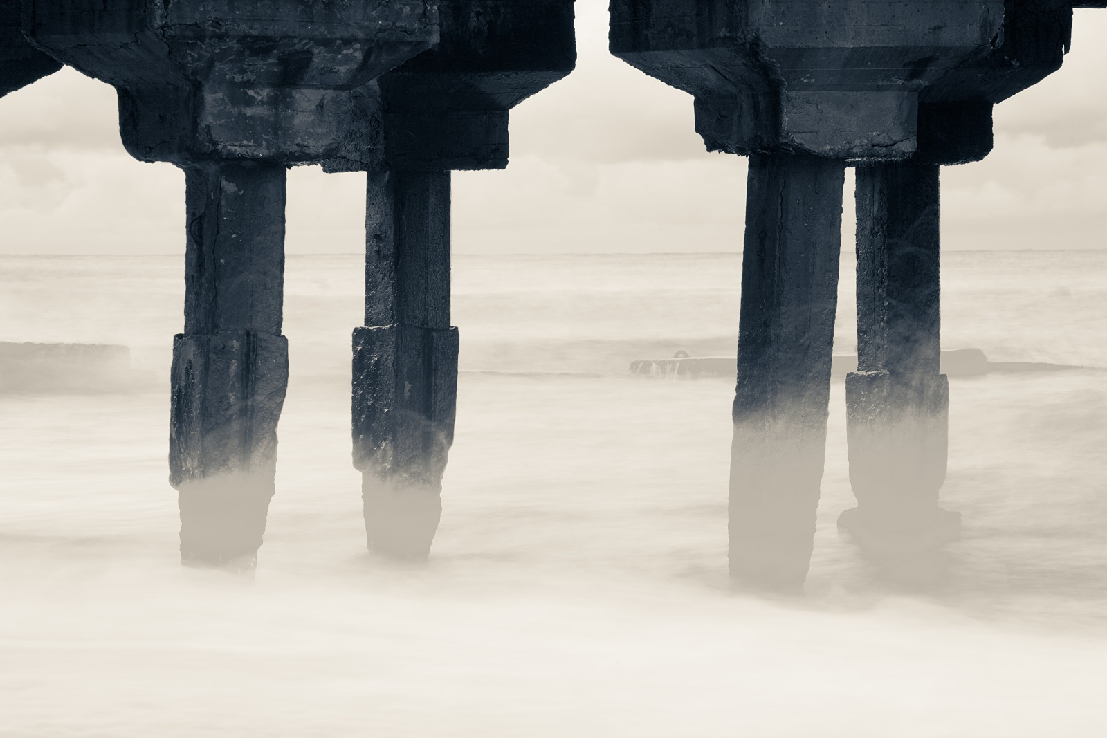 Concrete construction in the sea in twilight