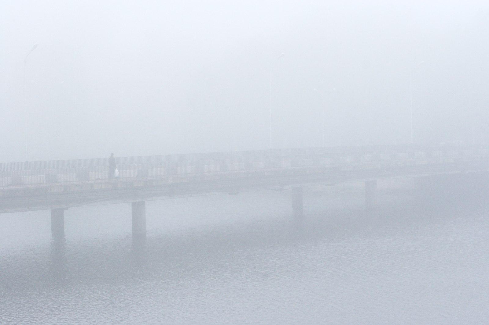 Silhuette on a bridge