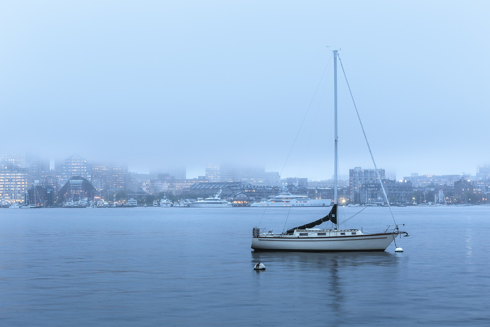 A boat and a foggy city