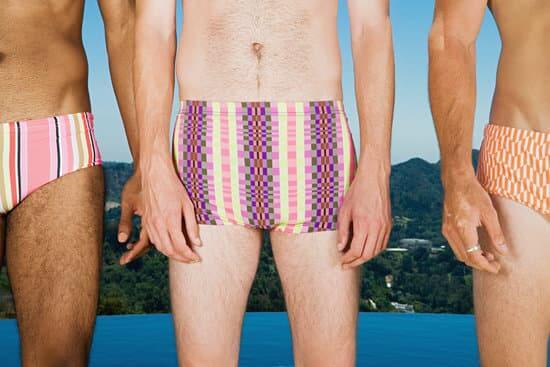 Row of men wearing swimming trunks