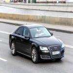Black Audi A8 on highway
