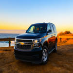 Blue 2018 Chevrolet Tahoe near the ocean in Malibu California