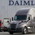 Gret Daimler Freightliner Cascadia in front of Daimler Building