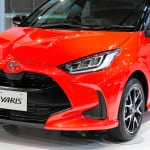 Red Toyota Yaris in Showroom