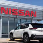 White Nissan Pathfinder in Nissan dealership
