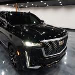 Black Cadillac Escalade in a showroom