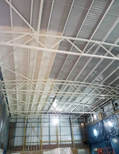 Monmouth secondary school turned this sports hall into a swimming pool  , so MPI sprayed the roof and steel work to prevent future condensation problems and also top up the existing insulation.