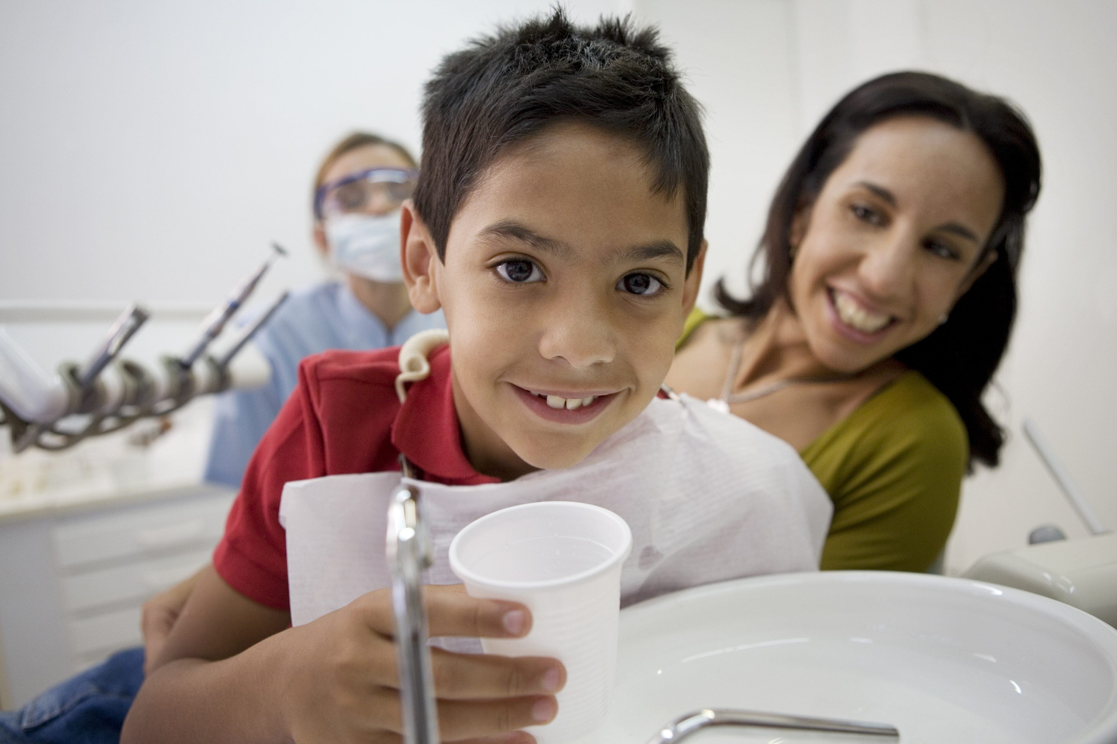 Boy rinsing after dental appointment