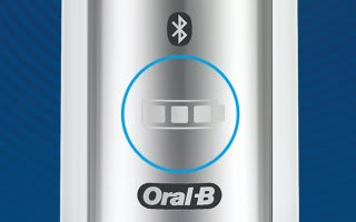 Close up of body of toothbrush showing battery icon