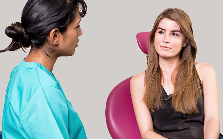 picture of dentist talking to a young lady in a black top