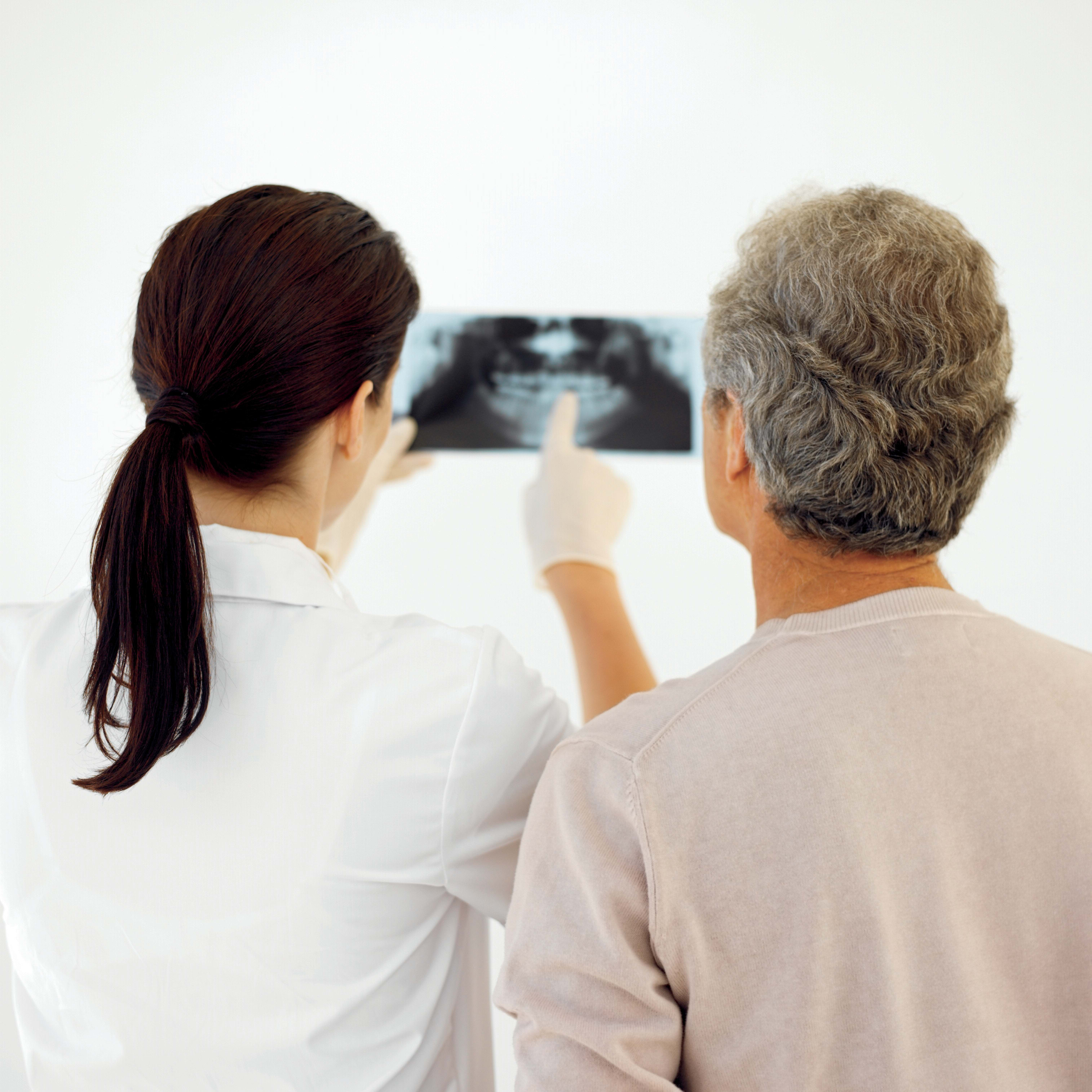 Dentist and patient reviewing a panoramic radiograph