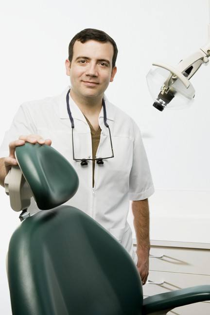 Dental care professional in surgery
