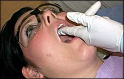 Palpating the hard palate.  Use firm pressure and try not to slide the fingers along the tissue.