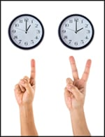 Photo of clocks and hands showing the passage of 2 hours.