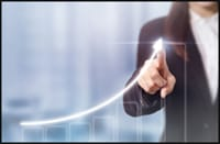 Business woman showing upward growth motion on a bar graph.