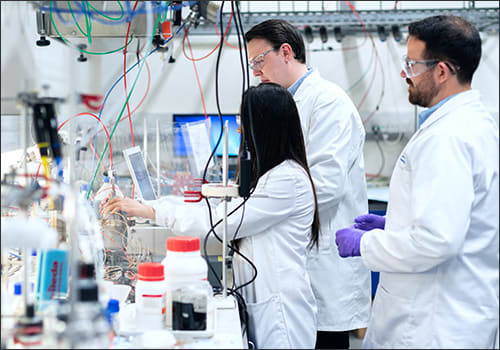 Photo of chemists developing a new toothpaste formulation