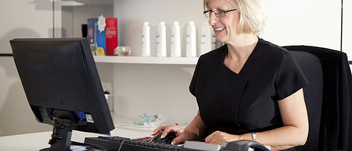 Dental Professional on Computer
