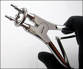 Image: Ring expanding pliers being used to expand ring.
